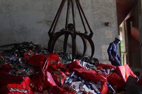 Tin nhanh - Tây Ninh: Tiêu hủy gần 600.000 gói thuốc lá giả nhập lậu (Hình 3).