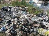 Môi trường - Hàng trăm tấn rác thải công nghiệp chưa xử lý thải ra môi trường