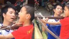 Mới- nóng - Màn nhổ răng bằng nỏ của hai bố con ở Lào Cai lên báo nước ngoài