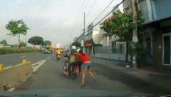 Mới- nóng - Clip: Cô gái bị hai tên cướp kéo lê hàng trăm mét trên đường