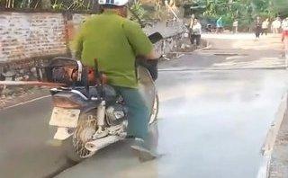 Mới- nóng - Sự thực về clip người mặc áo công an ngang nhiên đi vào đường mới làm