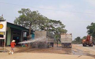Tin nhanh - Nghệ An: Quốc lộ biến thành điểm rửa xe, thanh tra bất lực?