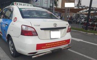 Kinh doanh - Dán khẩu hiệu gièm pha Uber, Grab, taxi Vinasun đang vi phạm luật Cạnh tranh