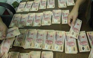 Pháp luật - Lào Cai: Bắt ổ nhóm tiêu thụ số lượng lớn tiền giả