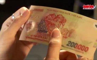 Tài chính - Ngân hàng - Xem số seri trên tờ tiền biết được tiền giả hay thật?