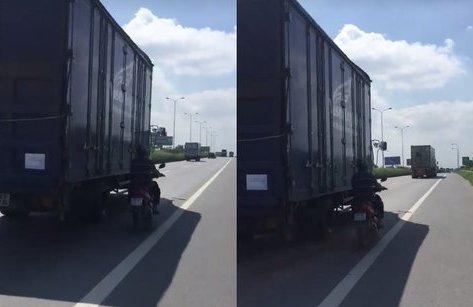 Xa lộ - Clip: Người đàn ông liều mạng chạy song song xe tải để 'tránh nắng'