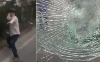 Video xe - Hà Nội: Ném vỡ kính xe tải, người đàn ông lớn tiếng thách thức